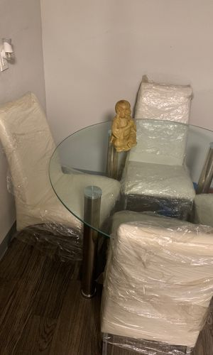 Kitchen is table Nd 4 chairs sliver and white wrapped brand new for Sale in Phoenix, AZ