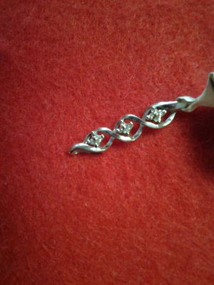 3 FLOWERS CHIP DIAMOND CHARM 10K WG for Sale in Orlando, FL