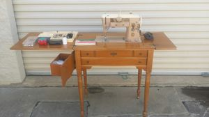 Singer 401a slant omatic sewing machine with cabinet and lots of extras for Sale in Plano, TX