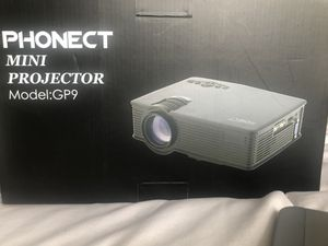 Brand New Phonect Mini Projector with a Lightning Digital AV Adapter for Sale in Westminster, CO