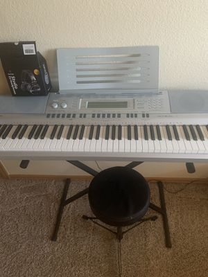 Casio wk 210 with seat and headphones for Sale in Westminster, CO
