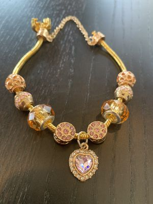 Gold plated charm bracelet with pale pink rhinestones for Sale in Lake Tapps, WA