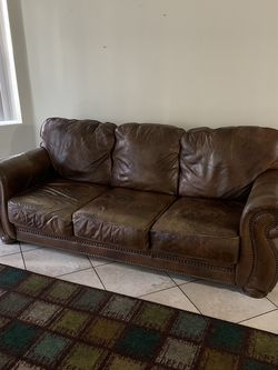 Real leather couch, little wear on the cushions for Sale in Las Vegas,  NV