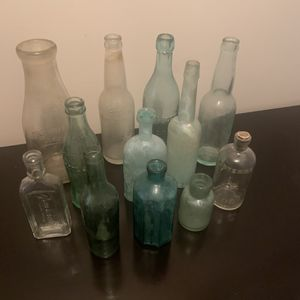 A Collection of 12 Antique Glass Bottles for Sale in Birmingham, AL