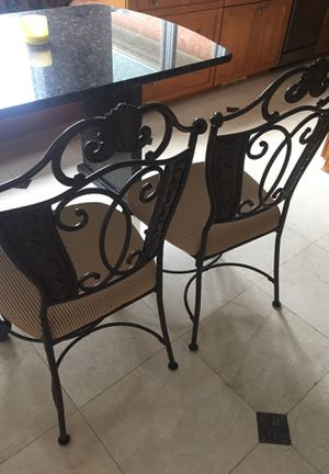 Two kitchen wrought iron chairs. In good condition. Very minor wear. I have 2 matching bar stools if interested for Sale in West Bloomfield Township, MI