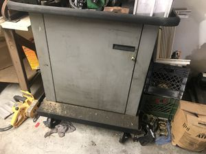 Heavy duty metal cabinet with door and shelves heavy duty top on casters with Electric for Sale in Glendale, AZ