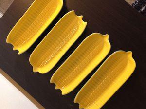 Le creuset corn dish set of 4 for Sale in Alexandria, VA