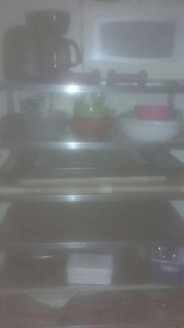 Stainless steel kitchen island on wheels.