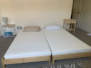 Stackable twin beds with two twin foam mattresses included -Ikea UTAKER for Sale in San Francisco, CA