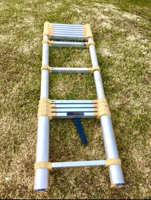 Ladder tubular becomes as 2 ft and tall about 14 I guess for Sale in Fresno, CA