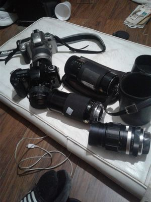 Canon eos rebel xs nikon n55 digital cameras lenses and cases for Sale in Alvin, TX
