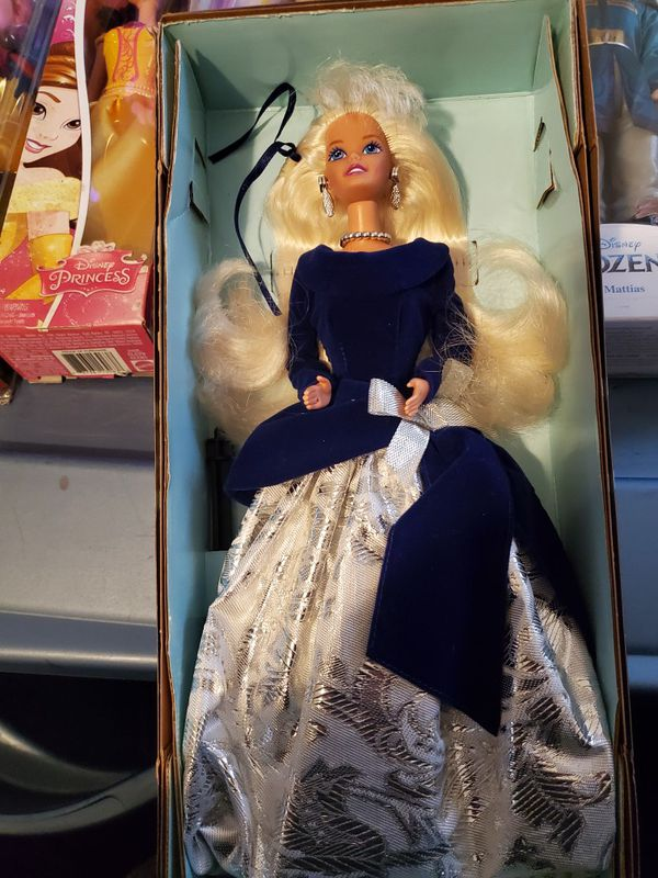 Collectible Barbie in her blue white and silver Christmas gown