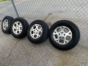 Jeep rims and tires for Sale in Westminster, MD
