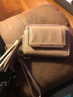 Michael Kors taupe wristlet for Sale in Baltimore, MD