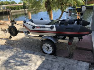 Like New Inflatable Boat Dinghy 4 Stroke motor with aluminum trailer for Sale in Hollywood, FL