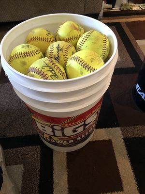 (31) 12' softball balls with bucket for Sale in Santa Ana, CA