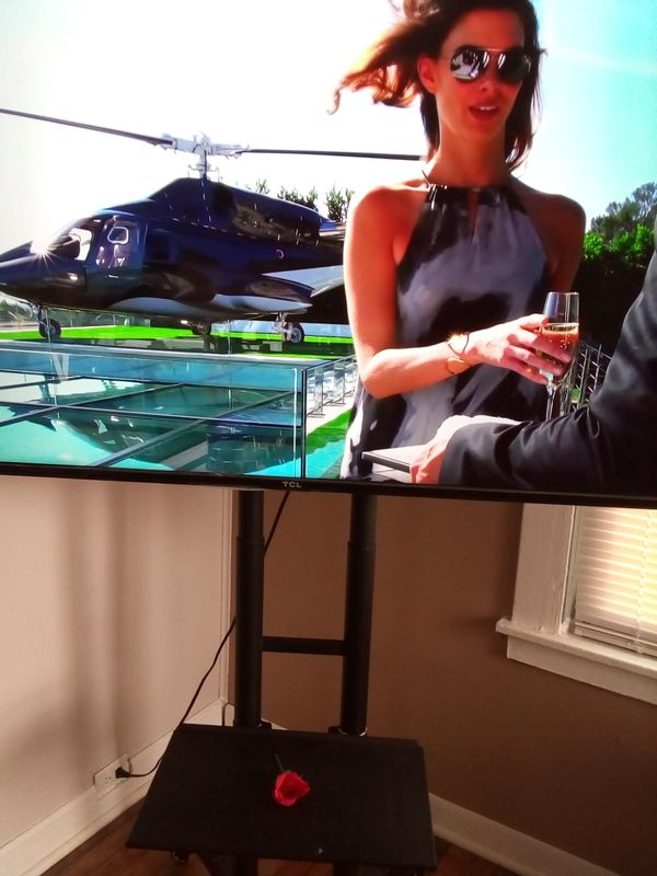 """""""55"""" TCL Roku Tv with stand"""