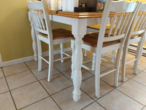 Kitchen table with 4 chairs and expandable integrated leaf for Sale in Frederick, MD