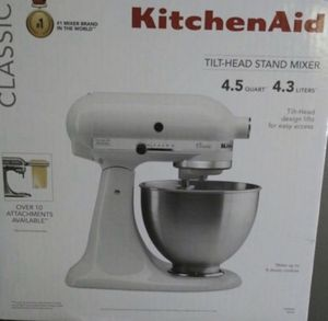 Kitchen Aid stand mixer by KitchenAid Brand New Never Opened mixer tilt head all attachments included price is Firm!!! $130 firm!!!! White for Sale in Ontario, CA