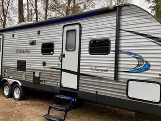 2019 COACHMEN CATALINA 35ft 2 BEDROOM. With 2 SLIDES. OUTSIDE KITCHEN for Sale in Spring,  TX