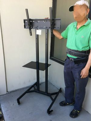 """New in box 28"""" depth x 26"""" wide x 65"""" tall 32 to 65 inch tv television heavy duty stand with locking wheels and shelf for Sale in Pico Rivera, CA"""