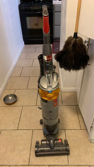 Two Dyson Slim vacuum cleaners red and gold for Sale in Lawndale, CA