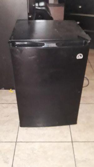 Mini black refrigerator and kitchen table for Sale in San Antonio, TX