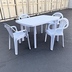 """New $80 Plastic Table Set and (4pcs) Armrest Chairs, Outdoor Patio Furniture, Table 54x33x28"""", Chairs 21x21x31"""" for Sale in South El Monte,  CA"""