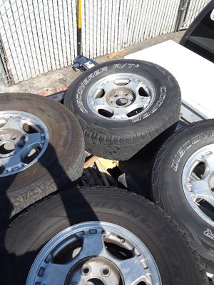 2000 Chevy Silverado tires and rims with caps for Sale in San Jose, CA