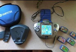Leap Frog Leapster learning multimedia Video gaming system with charger stand 6 games Electric plug-in,Batteries Great for kids four years old and u for Sale in Plainfield, IL