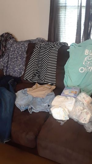 Maternity clothes diapers and nursing pads plus baby bathtub for girls for Sale in Denham Springs, LA