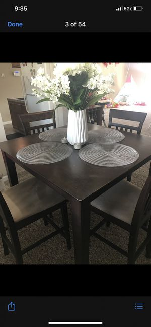 Dark brown pub table and 4 chairs for Sale in Modesto, CA