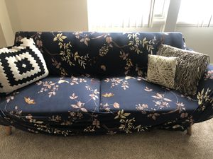 Futon couch with couch cover for Sale in Silver Spring, MD