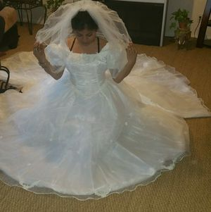 $220. Dlls size 12 Beautiful new wedding dress for Sale in Houston, TX