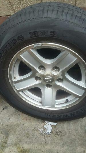 Dodge Durango rims tires,one tire needed as shown, 245/ 70R17. for Sale in Pennsauken Township, NJ