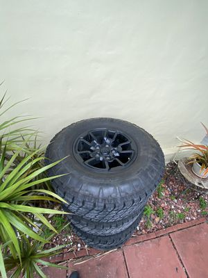 Dodge Ram rebel black out rim set 30 in tires on 18in rims for Sale in Hialeah, FL