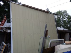 Two Matching 12Ft x 12Ft Aluminum Insulated Rolling Barn or Garage Doors for Sale in Tacoma, WA