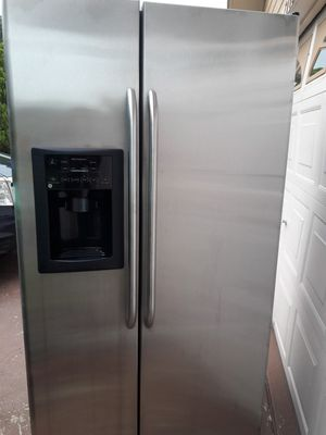 General electric refrigerator side by side stainless steel working fine very good condition for Sale in Ocoee, FL