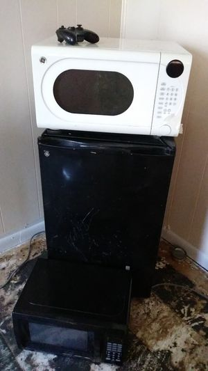 the white microwave in 15 the black in 10 and the refrigerator 40 for Sale in Bressler, PA