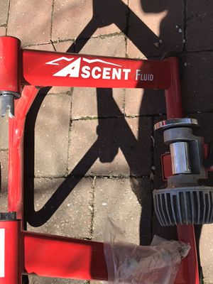 Red metal ASCENT bike trainer & front chock for Sale in Falls Church, VA