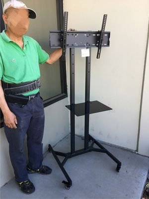 "New in box 28"" depth x 26"" wide x 65"" tall 32 to 65 inch tv television heavy duty stand with locking wheels and shelf for Sale in Whittier, CA"