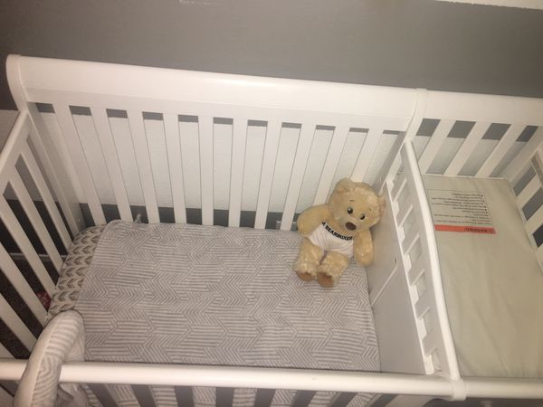 White crib with changing table