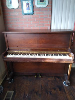 Piano solid wood brown cute for Sale in Boise, ID