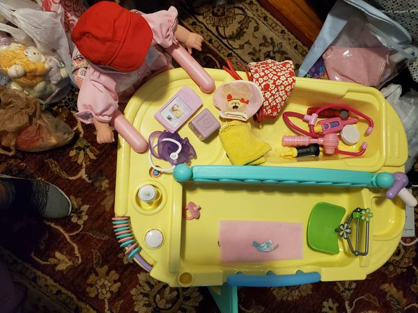 Adorable doll center loaded with fine accessories doll is brand new