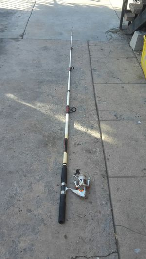Fishing rod and spinning reel. Long fishing rod for Sale in Vernon, CA