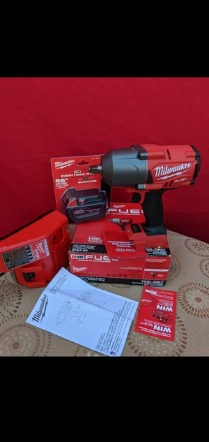 MILWAUKEE M18 FUEL 18-VOLT BRUSHLESS 1400 FT POUNDS 1/2 IN HIGH TORQUE IMPACT WRENCH WITH HIGH CAPACITY 5.0AH BATTERY AND KIT for Sale in San Bernardino, CA