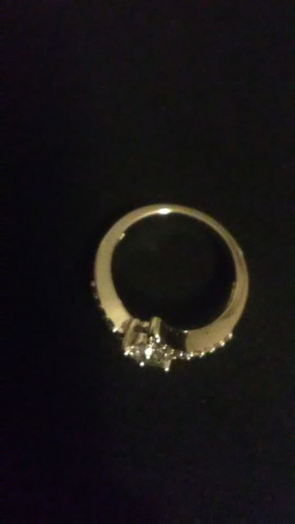 Size 6 white sapphire , he think he wet gold over 925 Sterling engagement/wedding ring