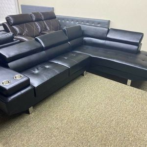 Black Leather Sectional with Adjustable Headrests for Sale in Atlanta, GA