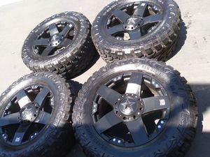 """20"""" rock star wheels and 4 use 35x12.5020 mt tires 60%tread. Fit 5x127 (jeep) for Sale in San Diego, CA"""
