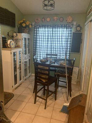 Kitchen table 4 chairs all wood it's about five years old for Sale in Riverview, FL